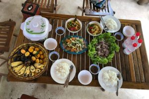 Eat with locals at a Khmer silk farm