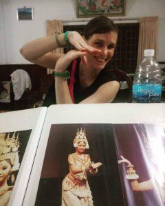A solo traveler in Cambodia at host Srey Moch learns Apsara dance basics