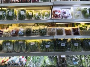 Vegetables packed in plastic and styrofoam in a supermarket