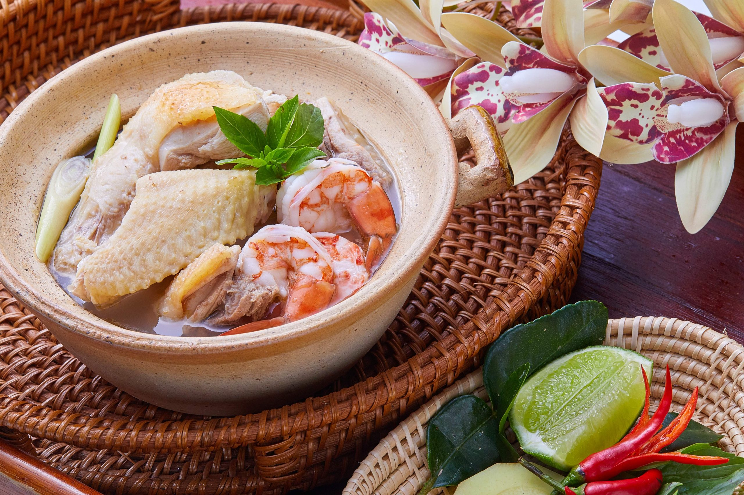 Chicken sour soup with shrimps