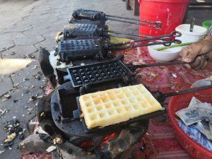 Ms Laum makes Nom Pom, the Khmer coconut waffles