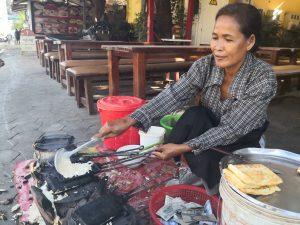 Mas laum makes Nom Pom, the Khmer coconut waffles