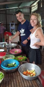 Guests cooking Khmer food in Phnom Penh