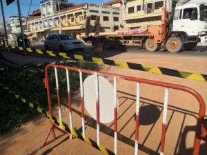 A street is blocked by tape and barriers. Siem Reap is currently a orange zone.